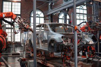 Factory robots building a car.