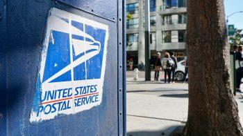 A US Postal Service mail box.